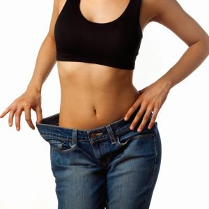 Weight Loss Hypnosis - Image of a female showing loose jeans from losing weight