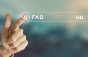 FAQ - Finger touches FAQ search on touchscreen