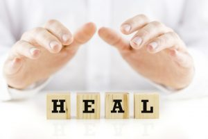 Hypnotherapy for healing - Healing hands facing downwards towards the word Heal