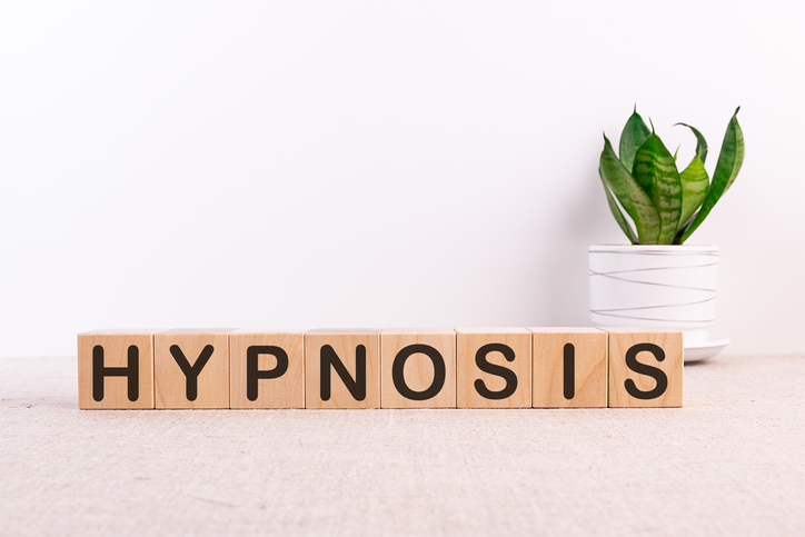 The word Hypnosis displayed on small blocks of wood